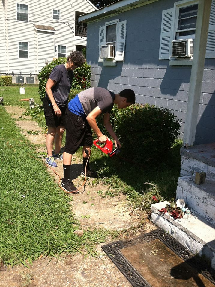 Rev. Melissa Hall and Austin Brown work together on some yard work