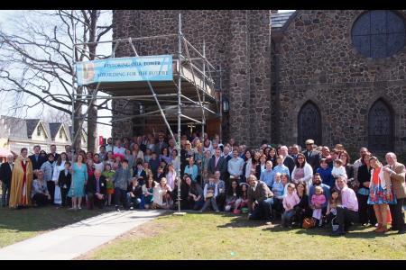 The congregation of St. James gathers on the Village Green after the 10:15 service on Easter Sunday.