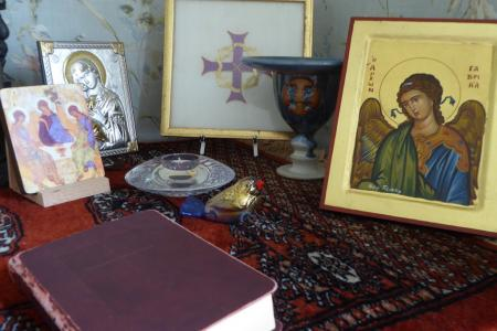 Rev. Audrey's sacred space  (The icon is from Greece- The Angel Gabriel, the smaller one is the Trinity, the needlework I did at the Community of St. John Baptist, Mendham, the metallic icon is Mary and the Infant Jesus)